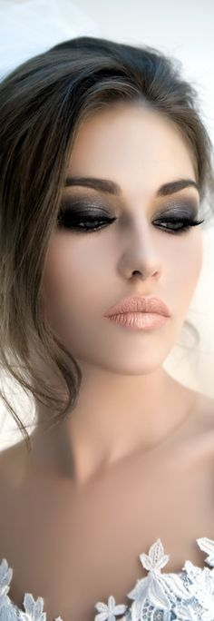 Smokey eyes, nude lips.