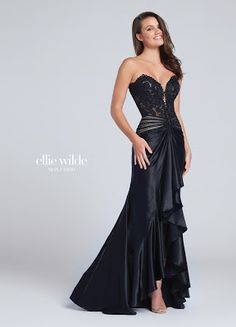 Strapless charmeuse sheath with plunging sweetheart neckline, lace and heat-set stone boned bodice with dropped waist, cascading ruffles and center front slit. Ellie Wilde by Mon Cheri Bodycon Prom Dresses, Homecoming Dresses, Strapless Dress Formal, Formal Dresses For Women, Elegant Dresses, Pretty Dresses, Designer Evening Gowns, Evening Dresses, Prom Boutiques