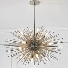 """12-Light Midcentury Modern Moonbeam Chandelier With starburst rays on Polished Nickel or golden Antique Brass, this 12 light contemporary chandelier adds modern or retro streams of light in the dining room or foyer. 12x40 watt candle sockets. (27""""-45""""Hx29""""W)"""