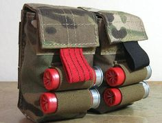 This is an amazing piece of MultiCam goodness: a shotgun shell double pouch that is set up for belt use or MOLLE webbing. It allows the carry of 24 shells.