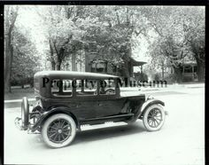 1929 photograph of sedan on Scioto St., Urbana, OH.  (The Champaign County Historical Museum)