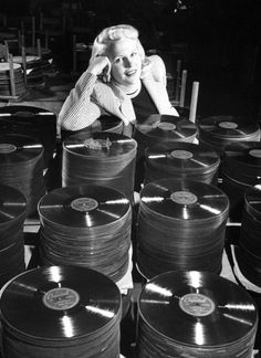 Peggy Lee posing w. a stack of her latest hit song Manana at Capitol Records, Photo by Allan Grant//Time Life Pictures/Getty Images. Latest Hit Songs, Latest Hits, Vinyl Junkies, Capitol Records, Record Players, Life Pictures, Mp3 Song, Vinyl Records, Vinyl Music