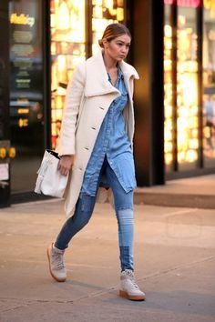Gigi Hadid wearing  Tom Ford Leather Small Tassel Bucket Bag, Nike Air Force 1 Hi Suede Sneakers, Black Orchid Denim Noah Mid Rise Super Skinny Jeans