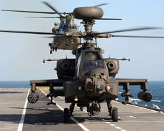 Army Air Corps Apache And RAF Chinook Helicopters Practice Deck Landings Onboard HMS Illustrious