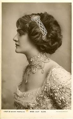 This stunning woman is the subject of this gorgeous photo. She employs a certain grecian flair with her hairpiece and whatnot. A lovely necklace, too. Lily Elsie, I believe. Obviously a very rich woman.