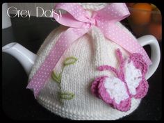 Pretty Flutterby Tea Cosy. Very girly, with butterfly on the front and a flower on the back. Embellished with beads and a button and topped off with a gorgeous spotty ribbon