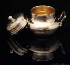 Puiforcat Tea Set - The elegant sugar bowl (OPEN) with vermeil (gold plated sterling silver) interior measures roughly 12.5 cm. high, 16.5 cm. across, including the handles  and weights roughly 593 grams.