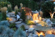 This backyard patio, designed by Alderwood Landscaping, provides a space for homeowners to take in the breathtaking views that surround the home. The patio's natural features, stone walkway & waterfall, make this space feel in harmony with its natural surroundings.