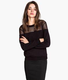 H&M Sweatshirt with Mesh Yoke $17.95 DESCRIPTION Long-sleeved sweatshirt with mesh sections. Ribbing at cuffs and hem. DETAILS 80% cotton, 20% polyester. Machine wash warm