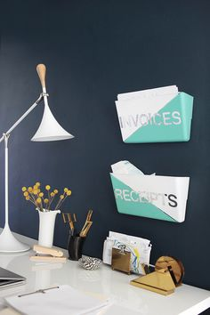 Label and paint clear plastic wall files for better organization. Tutorial from Emily Henderson.