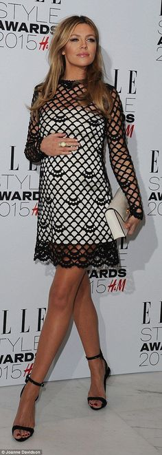 Stylish: Pregnant Abbey Clancy looked sensational in a black crocheted mini over a white c...