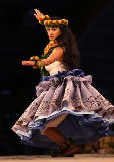 Images from the Miss Aloha Hula kahiko competition of the 2014 Merrie Monarch Festival