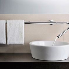 Bathroom tap faucet: long horizontal stainless steel metal that serves as a towel holder too. #minimalist #modern #interior