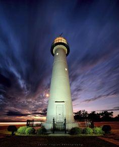 The Biloxi Beacon shines bright against a dramatic Mississippi Coast sky.