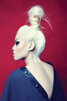 This hair style is one of my favourites. I like how the hair is not completely sleek back, its messy but effective. It looks very bold and strong, I like how the hair has been wrapped around its self, It creates a longer, exaggerated bun.
