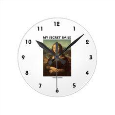 "My Secret Smile (da Vinci's Mona Lisa) Round Clock #leonardo #davinci #mysecretsmile #humor #geek #thinker #psyche #genius #funny #wordsandunwords Here's a clock featuring Leonardo da Vinci's infamous masterpiece, the Mona Lisa, along with the title ""My Secret Smile""."