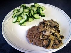 Mushroom burger and cucumber salad: 4oz lean, local, grass-fed beef burger with 1/2 c mushrooms sauteed in olive oil and 1/2 c fresh cucumbers drizzled with 1 tsp lite Caesar dressing
