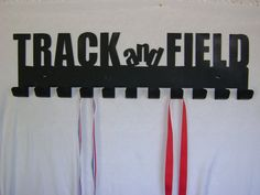Track and Field Medal Display hooks by SecondHandMetalArt on Etsy, $30.00