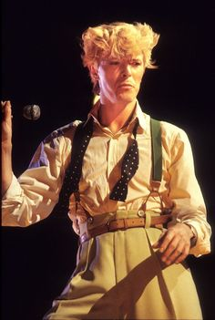 Bowie performs on stage for the Serious Moonlight tour in Rotterdam, Netherlands, June 25, 1983. He shows off a quintessential new wave '80s look, with suspenders, high-waisted trousers, and coiffed hair.