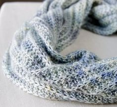 Suitable for most yarn types, this easy-to-wear Cool Breeze Infinity Cowl is just what you need this winter.  Rich texture, made possible by the Cartridge Belt Rib stitch, blends elegantly with the varying shades of blue featured on this knit cowl.