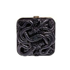 entwined dragons serpent clutch purse Emilio Pucci  -  Minaudière en métal et dragons sculptés.