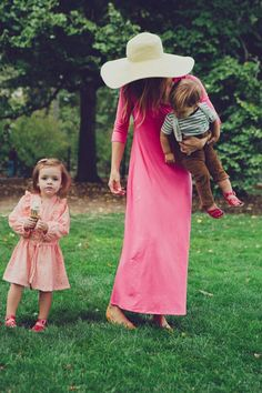Pink flowing dress with a kid on the hip- I can only dream of this fashionable peace with my kids!