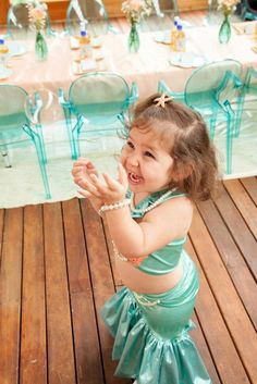 Mermaid girl under the sea party via Kara's Party Ideas! KarasPartyIdeas.com | over the top, but I love the clear blue chairs!