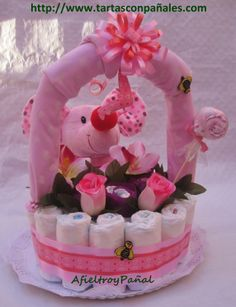 Tarta Cesta de flores de pañales. Si quieres más información sobre esta tarta puedes encontrarla en: http://www.tartasconpanales.com/index.php?route=product/product&path=59&product_id=61 #Floresdepañales #Cestadefloresconpañales #Tartasconpañales #Tartasdepañales #Pañales #Pañalesecologicos #AfieltroyPañal #Regalosparabebes #Regalosparaembarazadas #Regalosparabautizos #Regalosconpañales