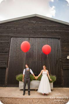 wedding couple big red balloons Tewin Bury Farm.