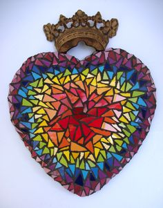 "c. 2012, Krystie Rose Millich. ""Corazon del Arco Iris"" (Rainbow Heart). Glazed ceramic tiles on molded metal base."
