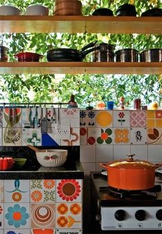 Colorful kitchen. Like the high windows with shelves in front
