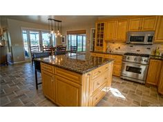 The chefs kitchen has Viking stainless steel appliances, smart cabinetry, center island a walk in pantry and office nook.