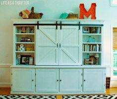 Entertainment center shelves via Life as a Thrifter