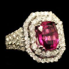 Square Rubellite Diamond Ring. Accompanied by 3.50 karats of Rubellite and 2.15 karats of Diamonds. Set in 18 karat White Gold.