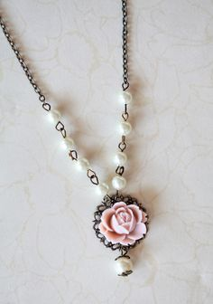 "Vintage Beginning Indie Necklace 39.99 at shopruche.com. Feminine and oh-so-romantic, this vintage-styled brass necklace is adorned with luminescent faux pearls and an ornate filigree pendant centered with a charming pink resin rose.18"" long, Pendant: 1"" diameter"