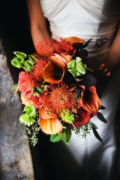 Fall orange calla lily bouquet with green and coral accent flowers  {Wedding Planning: www.ashleybaberweddings.com}