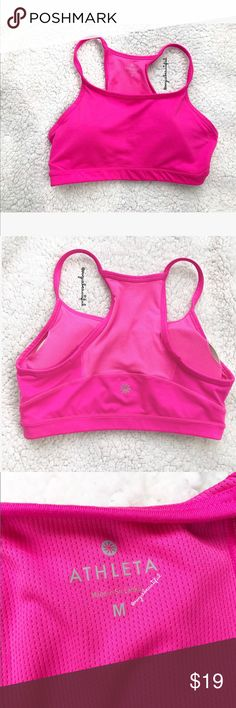 Athleta Pink Sports Bra Pink Athleta Sports Bra in size medium - excellent preloved condition, no stains- includes original padding - color varies slightly from photos, it is a bright pink -  !!NO TRADES!! Athleta Tops