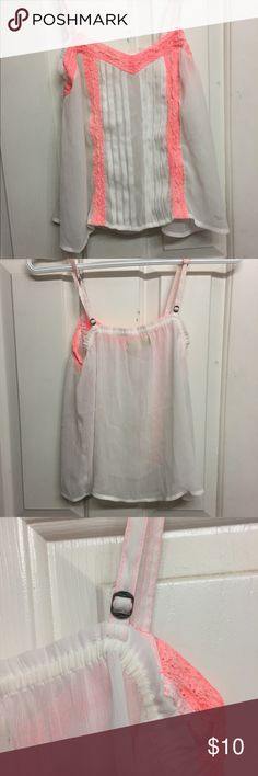 Sheer white with neon pink tank Perfect for the summer when you don't want to really wear clothes but still get into places that require a shirt. This tank is super lightweight, sheer, and has a cute pop of color for the summer. Wear it with a bralette or over a bathing suit top. It even has adjustable straps. Great condition! The only thing I did when I wore it was cut the tag off on the inside because it was showing with the sheerness of the shirt. Hollister Tops Tank Tops