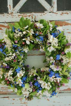 Flower wreath on old door