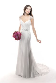 """Brides.com: Wedding Dresses We Love For Under $1,500. Ruching and embellishment around the waist draws attention away from anything but your teeny tiny middle.  Style 4MC897, """"Bryce"""" wedding dress, $1,129, Maggie Sottero  See more Maggie Sottero wedding dresses."""