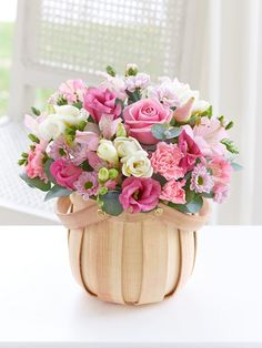 If pink is their favourite colour, then this pretty display of wonderfully feminine pink flowers is sure to be their favourite gift too. Carefully arranged in a petite wooden basket, they will discover carnations, lisianthus and chrysanthemums as well as delicately scented freesias and Eucalyptus Cinerea.<br /><br />Featuring 2 pink alstroemeria, 3 white freesias, 1 pink lisianthus, 1 pink rose, 1 pink spray carnation and 1 pink spray chrysanthemum with eucalyptus cinerea, presented in a…
