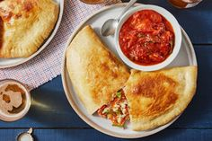 Fontina & Ricotta Calzones with Gypsy Peppers, Heritage Globe Tomatoes, & Basil