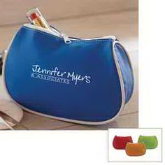 """Build some beautiful business relationships with this promotional bag! Give your marketing campaign a full makeover by handing out this travel companion. Measuring 7"""" x 5"""", this deluxe cosmetic bag features a spacious interior, 2"""" gusset, zipper closure and white piping accent. Great for beauty counter incentives, travel agency giveaways and a variety of other venues, the vinyl exterior can be imprinted with your company name and logo"""