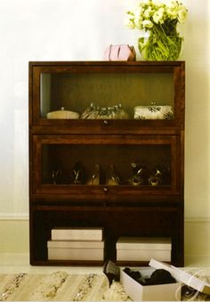 Lawyers cabinets to display handbags and shoes.
