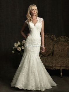 Allure Wedding Dresses, Spring 2012. This slim, fitted gown in all-over lace features a beautiful neckline with contoured straps that continue to a keyhole back. A chapel length train and covered buttons complete this elegant style.