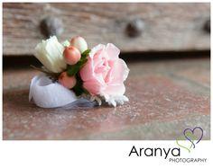 Pale pink rose and berry winter wedding wrist corsage shot by Kent wedding photographer, Sarah Khamsoda, of Aranya Photography at Leeds Castle http://www.aranyaphotography.co.uk/