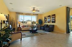 Very bright living area in The Anchor model in Tampa, Florida. Yellow walls are very cheerful!