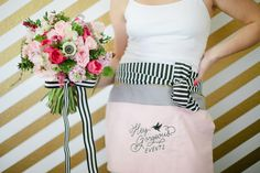 Vendor apron made by @McKay Pittman and bouquet by Hey Gorgeous Events. Photo by @Shalyn Nelson