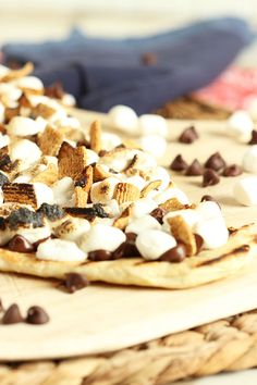 A summer classic reinvented, Grilled S'mores Pizza is cooked directly on the grill grates for the crispiest crust ever. | The Suburban Soapbox