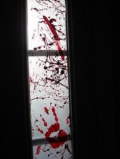 Bloody Windows. wax paper, red paint, tape, scissors and a paint brush